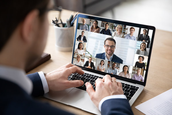 Photo of a man on a video call on a laptop